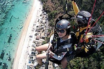 Paragliding above the beautiful Bali coastline.