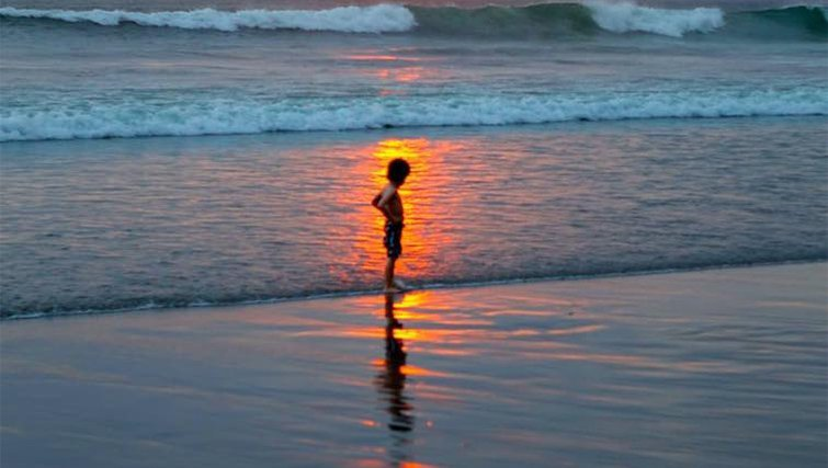 kid on the beach in Bali