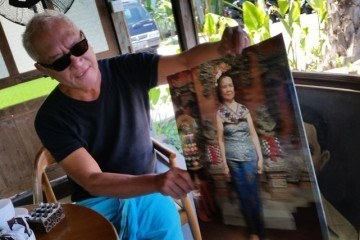 Lonny Gerungan shows a picture of his mother at his new restaurant.