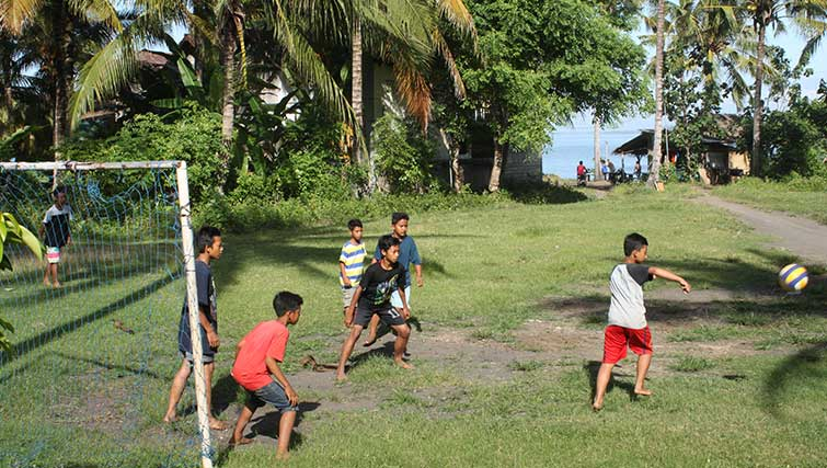 A game of soccer by Medewi Beach