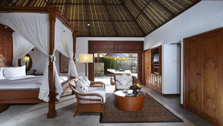 The luxury villa with traditional Balinese architecture at The Oberoi